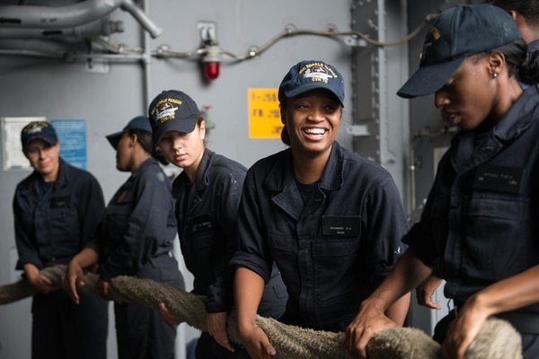 Deck department sailors pull in a mooring line on the carrier Reagan. Sailor morale appears to be on the rise ever since the Navy began implementing measures to ensure sailors are rested. (MC3 James Lee/Navy)