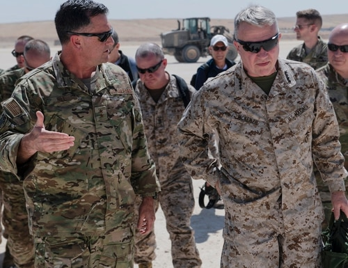 Marine Corps Gen. Frank McKenzie, U.S. Central Command commander, and Air Force Maj. Gen. Eric Hill, Special Operations Joint Task Force – Operation Inherent Resolve commander, discuss the efforts to destroy the remnants of Daesh in Syria July 22, 2019. (Spc. Alec Dionne/Army)