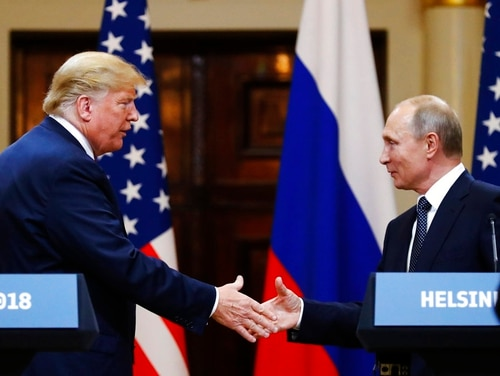 U.S. President Donald Trump shakes hand with Russian President Vladimir Putin at the end of the press conference after their meeting at the Presidential Palace in Helsinki, Finland, Monday, July 16, 2018. (Alexander Zemlianichenko/AP)