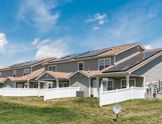 Solar panels installed on the back side of housing units on Dover Air Force Base in Delaware absorb sunlight to generate electricity on May 11, 2018. New legislation about to be signed into law would give base contractors more housing funding than troops receive on their own. (Roland Balik/Air Force)