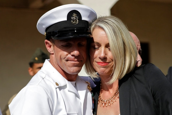 "Special Warfare Operator Chief Edward ""Eddie"" Gallagher, left, and his wife Andrea hug after leaving the Naval Base San Diego courthouse on Tuesday. (Gregory Bull/AP)"