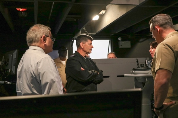 Vice Chief of Naval Operations Adm. Bill Moran listens as staff members from Surface Warfare Officers School explain the functions of the full bridge simulator. (Lt. Megan Chester/Navy)
