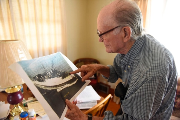 In thisOct. 27 photo, Junior Jennings, 86, who witnessed the first testing of the hydrogen bomb on Nov. 1, 1952, points to a photo at his home in Danville, Va. (John Crane/Danville Register & Bee via AP)