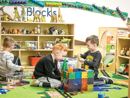 Three boys play in the block area of the Ivy Child Development Center at Fort Carson, Colo., on March 13, 2020. (Amber Martin/Army)