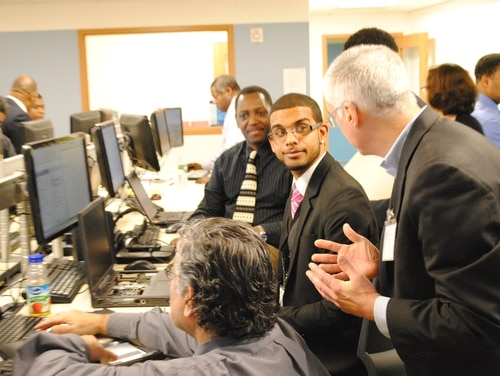 EPA Deputy Administrator Bob Perciasepe converses with students of the Per Scholas IT Training and Job Placement Program in the Bronx.