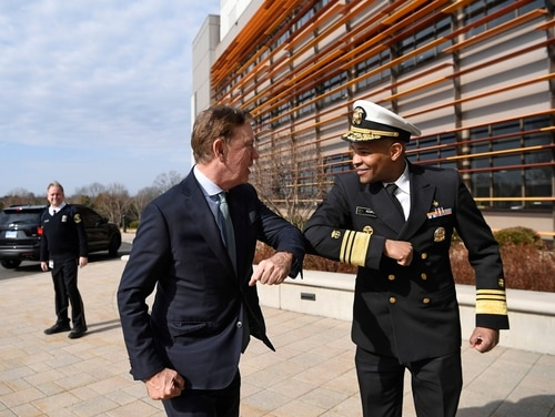U.S. Surgeon General Vice Adm. Jerome M. Adams, right, bumps elbows with Connecticut Gov. Ned Lamont as they meet for a visit at the Connecticut State Public Health Laboratory on Monday in Rocky Hill, Conn. The Surgeon General is encouraging people to bump elbows rather than shaking hands or fist bumps to help prevent the spread of COVID-19. (Jessica Hill/AP)