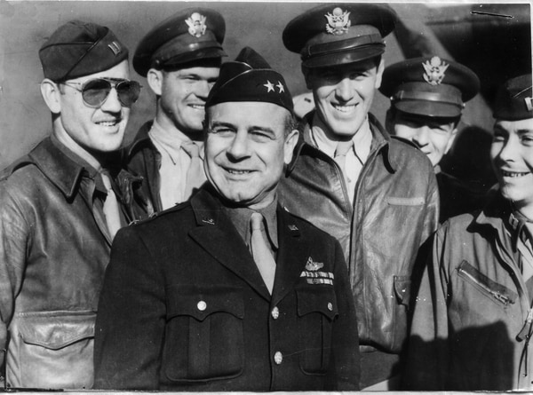 Lt. Gen. James H. Doolittle, center, commander of the Army Air Forces Eighth Air Force, is surrounded by a group of U.S. flyers. (Air Force)