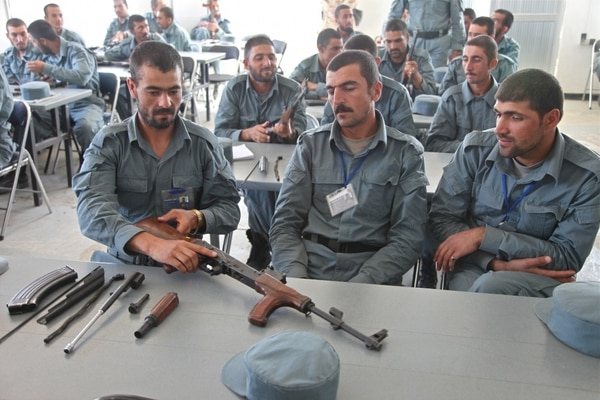 A group of Afghan Uniform Police recruits dissemble their AK-47 assault rifles to demonstrate to their instructor what they have learned at Forward Operating Base Shank, Logar province, Afghanistan on July 2, 2012. (Spc. Austin Berner/U.S. Army)