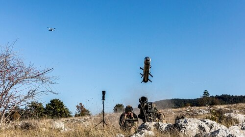 French soldiers are seen firing an anti-tank missile, as a micro-drone providing targeting information hovers above. (Photo by Laurent Guichardon/MBDA)