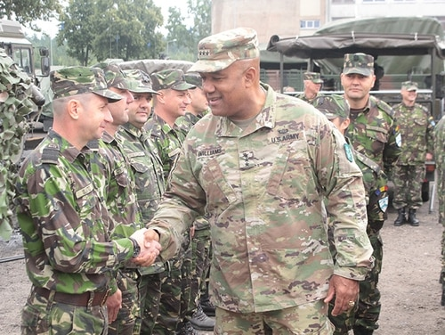 Lt. Gen. Darryl Williams, NATO LANDCOM commander, meets with Battle Group Poland Romanian soldiers at the Bemowo Piskie Training Area. The U.S.-led NATO Battle Group, including U.K. and Romanian soldiers, arrived as a deterrence force in northeast Poland in support of NATO's Enhanced Forward Presence. (Sgt. Jimmy Golden/Army)