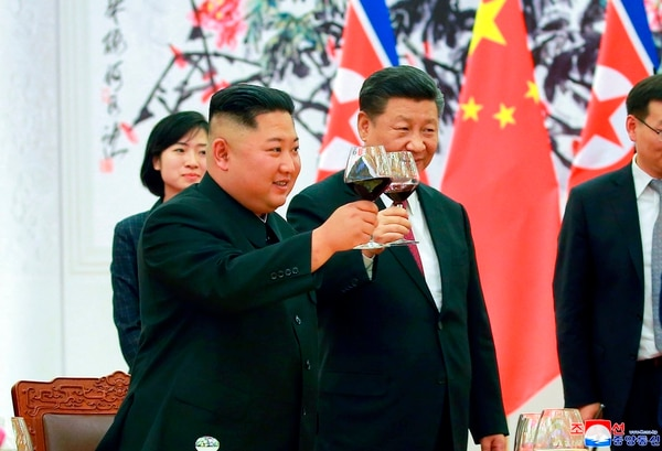 In this June 19, 2018, photo provided on June 20, 2018, by the North Korean government, North Korean leader Kim Jong Un, left, toasts with Chinese President Xi Jinping, at the Great Hall of the People in Beijing, China. (Korean Central News Agency/Korea News Service via AP)