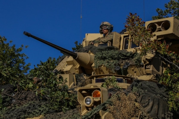 First Lt. William Malcom, of 1st Armored Brigade Combat Team, 1st Infantry Division, scans the area in a Bradley Fighting Vehicle during a combined arms live-fire exercise at Novo Selo Training Area, Bulgaria, Sept. 27, 2018. (Spc. Deomontez Duncan/Army)