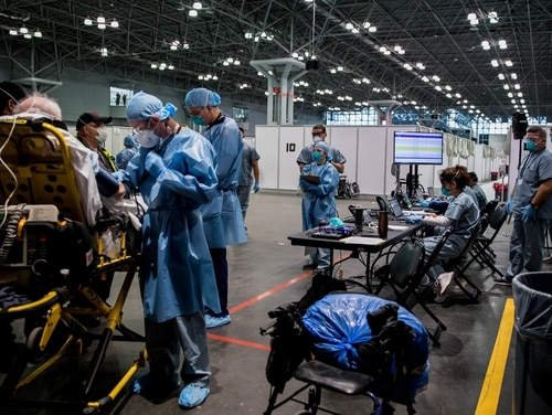 Soldiers from the 9th Hospital Center takes a patient's blood pressure reading in the Javits New York Medical Station. (DoD)