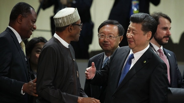 Chinese President Xi Jinping, right, greets Nigerian President Muhammadu Buhari during a plenary session of the 2016 Nuclear Security Summit on April 1, 2016, in Washington, D.C. The summit was organized to highlight accomplishments and make new commitments toward reducing the threat of nuclear terrorism. (Alex Wong/Getty Images)