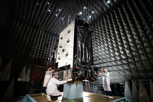 This March 22, 2016, photo provided by Lockheed Martin shows the first GPS III satellite inside the anechoic test facility at Lockheed Martin's complex south of Denver. The facility is used to ensure the signals from the satellite's components and payload will not interfere with each other. The satellite is scheduled to be launched from Cape Canaveral, Fla., on Tuesday, Dec. 18, 2018. (Pat Corkery/Lockheed Martin via AP)