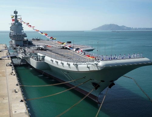 China's aircraft carrier Shandong is docked at a naval port in Sanya in southern China's Hainan Province on Dec. 17, 2019. New satellite imagery from late 2020 suggests Beijing is beefing up its naval support infrastructure in the area. (Li Gang/Xinhua via AP)