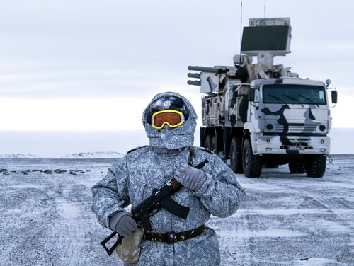 A Russian soldier stands guard on Wednesday near a Pansyr-S1 air defense system on the Kotelny Island, part of the New Siberian Islands archipelago located between the Laptev Sea and the East Siberian Sea. (Vladimir Isachenkov/AP)