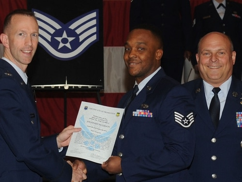 Col. Leland Bohannon, left, then-2nd Bomb Wing vice commander, presents a certificate of promotion during a ceremony on Barksdale Air Force Base, Louisiana, Jan. 31, 2014. (Air Force)