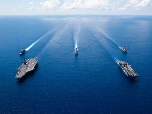 The aircraft carrier USS Ronald Reagan (CVN 76), left, and the amphibious assault ship USS Boxer (LHD 6) and ships from the Ronald Reagan Carrier Strike Group and the Boxer Amphibious Ready Group are seen in formation Oct. 6, 2019, in the South China Sea. (Mass Communication Specialist 2nd Class Erwin Jacob V. Miciano/Navy)