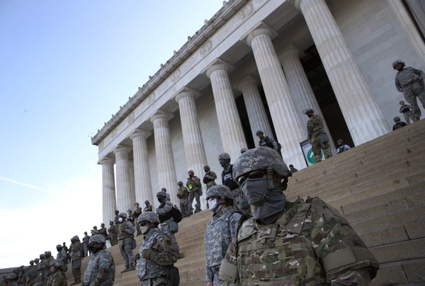 Members of the D.C. National Guard stand on the steps of the Lincoln Memorial as demonstrators participate in a peaceful protest against police brutality and the death of George Floyd, on June 2, 2020 in Washington, DC. (Win McNamee/Getty Images)