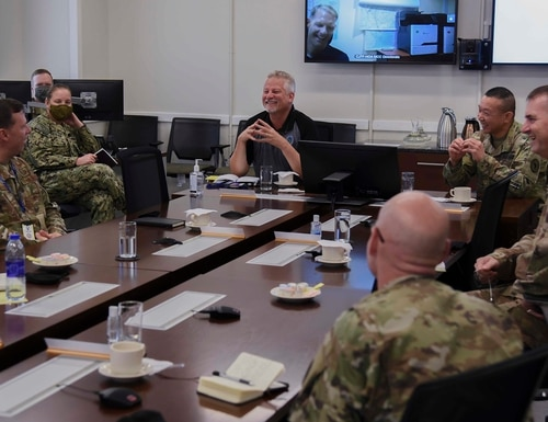 Ambassador Andrew Young, deputy to the commander for civil-military engagement, U.S. Africa Command, talks with senior leaders during a battlefield circulation, Sep. 18, 2020, at the CJTF-HOA headquarters building, Camp Lemonnier, Djibouti. Young spent almost 30 years in diplomatic service on four different continents. (Senior Airman Kristin Savage/Air Force)