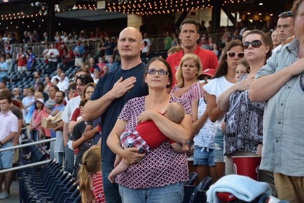 Chief Petty Officer William Hall out of Naval Air Station Patuxent River, Maryland, his wife, Monica, and son, Issac, attend the Washington Nationals vs. Atlanta Braves game as part of the military community outreach program Nats on Base, June 22. (Kristine Froeba/Staff)