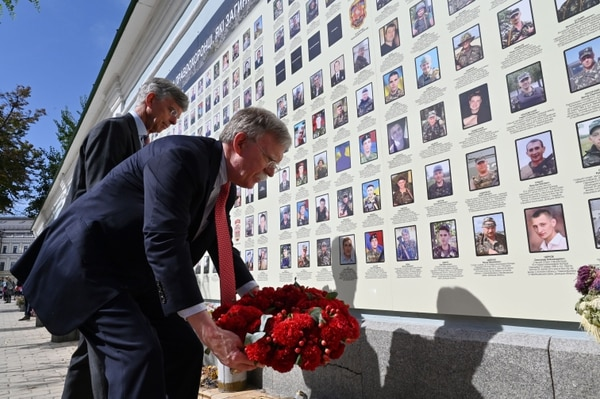 National security adviser John Bolton, right, and former U.S. ambassador to the Ukraine and current Chargé dAffaires a.i. William Taylor, lay a wreath at a memorial for those killed in the war against Russia-backed separatists in the Donbass region during ceremony in Kiev on Aug. 27, 2019. (Sergei Supinksy/AFP via Getty Images)