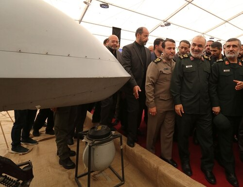 Iranian Revolutionary Guard commander Maj. Gen. Hossein Salami, second right, and Gen. Amir Ali Hajizadeh, right, the head of the Revolutionary Guard's aerospace division, visit Tehran's Islamic Revolution and Holy Defense museum during the unveiling of an exhibition of what Iran says are U.S. and other drones captured in its territory, in the capital Tehran on Sept. 21, 2019. (Atta Kenare/AFP via Getty Images)