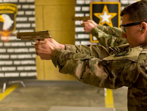 A soldier with the 101st Airborne Division fires the new M17 or Modular Handgun System. Gun maker Sig Sauer will sell 5,000 of the guns to the public next year. (Sgt. Samantha Stoffregen/Army)