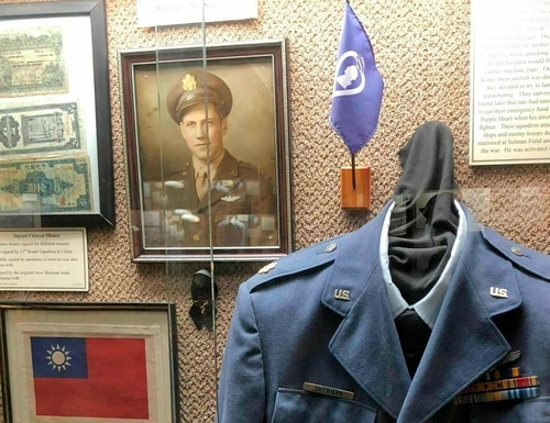 This undated photo provided by the Chennault Aviation and Military Museum in Monroe, La., shows an exhibit of artifacts from Maj. Richard Sherman, who flew 52 missions over China during World War II. Sherman was in the 11th Bomb Squadron of the Army's 14th Air Force under Gen. Claire Chennault, who nicknamed the 14th the Flying Tigers after the volunteer fighter group he had created while acting as a civilian advisor to nationalist China to defend that nation before the U.S. entered World War II. Sherman died Wednesday, Jan. 9, 2019, in Monroe. (Nell Calloway/Chennault Aviation and Military Museum via AP)