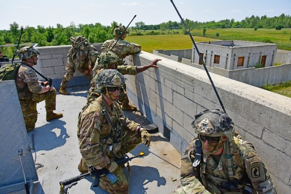 Paratroopers assigned to the 503rd Infantry Regiment, 173rd Airborne Brigade, provide security at a drop zone in Pordenone, Italy on June 20, 2019. (Army)