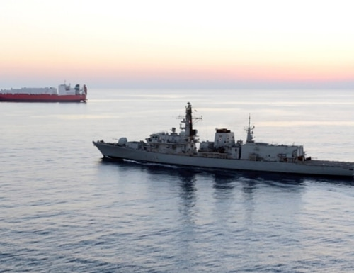 British navy vessel HMS Montrose escorts another ship during a mission to remove chemical weapons from Syria at sea off coast of Cyprus in February 2014. (UK Ministry of Defence via AP)