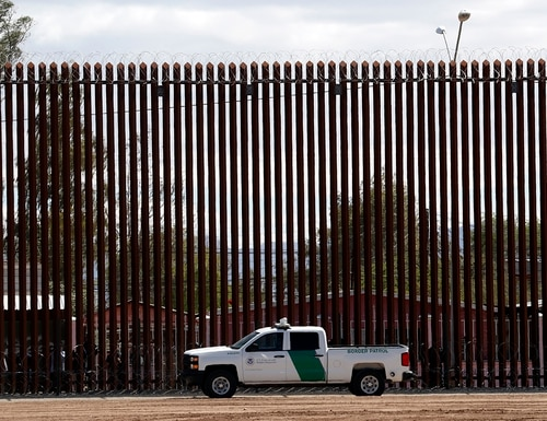 In this April 5, 2019, file photo, a U.S. Customs and Border Protection vehicle sits near the wall as President Donald Trump visits a new section of the border wall with Mexico in El Centro, Calif. (Jacquelyn Martin/AP)