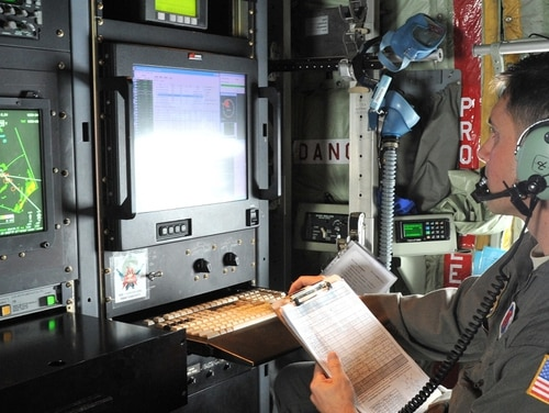 Maj. Jeremy DeHart, a 53rd Weather Reconnaissance Squadron aerial reconnaissance weather officer, reviews data on Hurricane Michael before sending it to the National Hurricane Center. (Master Sgt. Jessica Kendziorek/Air Force)