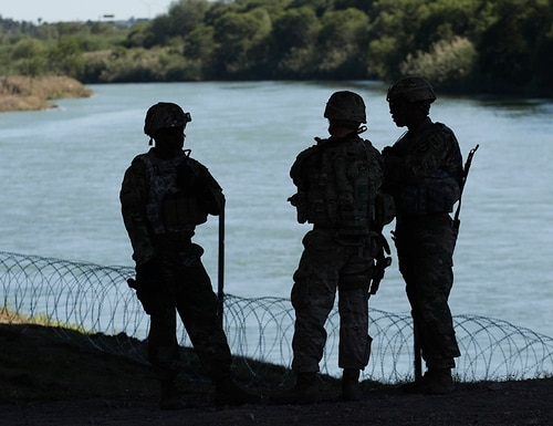 Members of the U.S. military install multiple tiers of concertina wire along the banks of the Rio Grande near the Juarez-Lincoln Bridge at the U.S.-Mexico border on Nov. 16, 2018, in Laredo, Texas. (Eric Gay/AP)