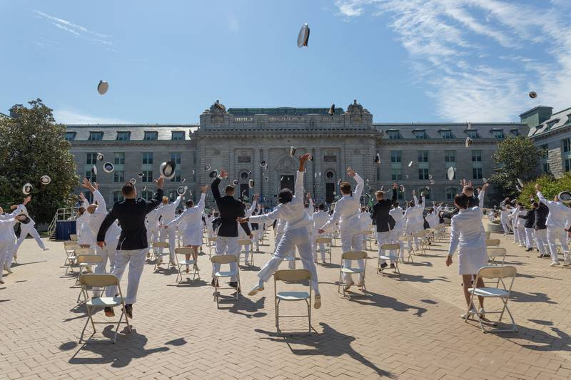 Midshipmen toss their covers May 14, 2020, concluding the second swearing-in event for the United States Naval Academy Class of 2020 in Annapolis, Md.