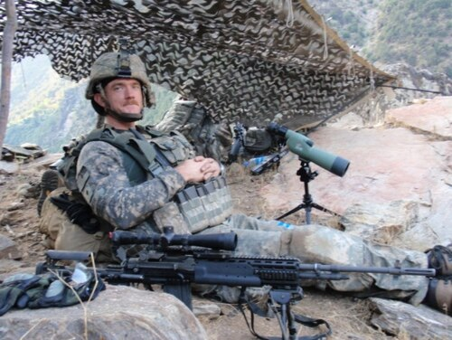 Spc. Ty M. Carter provides security for Afghans voting on election day, from halfway up North Face Mountain near Combat Outpost Keating. Courtesy photo