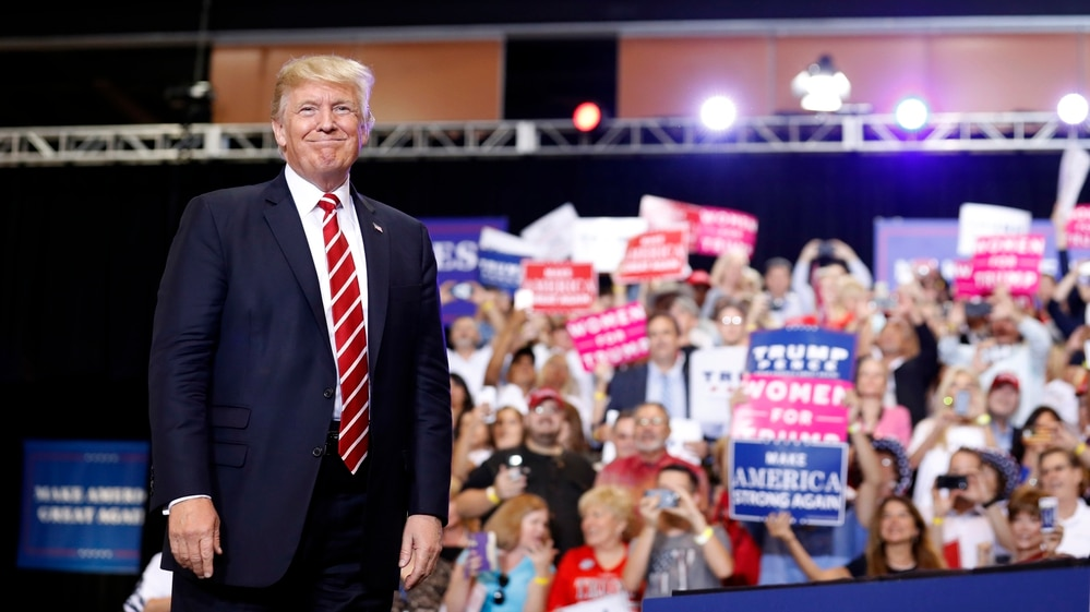 President Donald Trump stands before speaking at a rally at the Phoenix Convention Center, Tuesday, Aug. 22, 2017, in Phoenix. (Alex Brandon/AP)