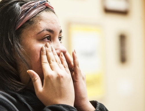 Denisse Willis cries while recounting her experience with Technical Sgt. Sean Russell and Staff Sgt. Joseph Stalzer helping to save her 18-month-old baby Aryanna Willis during an interview on Malmstrom Air Force Base Friday, Jan. 29, 2016.