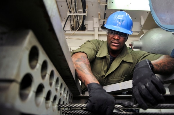 151214-N-IJ275-021 NEWPORT NEWS, Va. (Dec 14, 2015) – Aviation Boatswain's Mate (Equipment) 3rd Class James Fisher,a Sailors assigned to the Nimitz-class aircraft carrier USS Abraham Lincoln (CVN 72), participates in a cable rereaving in the engine room, Dec. 14. Lincoln is undergoing a Refueling and Complex Overhaul (RCOH) at Newport News Shipbuilding, a division of Huntington Ingalls Industries. (U.S. Navy photo by Mass Communication Specialist 3rd Class Ciarra C. Thibodeaux/Released)