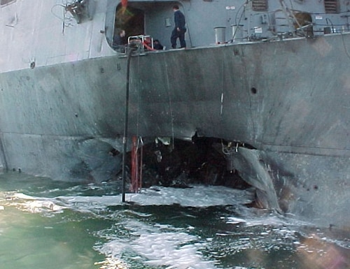 The explosion on the ship's port side left a 40-by-60-foot hole. (US Navy photo)
