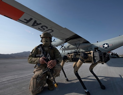Tech. Sgt. John Rodiguez provides security with a Ghost Robotics Vision 60 prototype at a simulated austere base during the Advanced Battle Management System exercise on Nellis Air Force Base, Nev., on Sept. 1, 2020. (Tech. Sgt. Cory D. Payne/U.S. Air Force)
