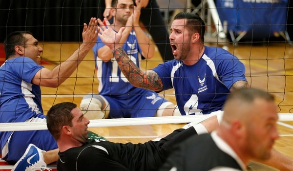 Retired Staff Sgt. Steven Malits celebrates a point over Army in Air Force's first sitting volleyball match of the 2014 Warrior Games at the US Olympic Training Center in Colorado Springs on Sunday, September 28, 2014. (Mike Morones/Staff)