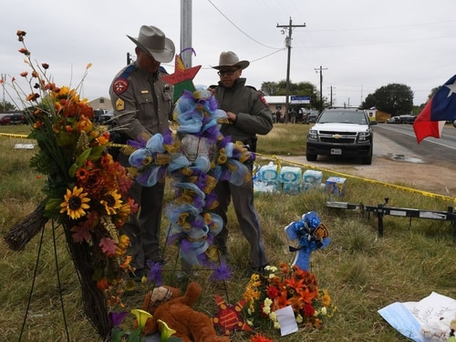 State troopers check a memorial outside the First Baptist Church on Nov. 8, 2017. The church was the scene of the mass shooting that killed 26 people in Sutherland Springs, Texas. (Mark Ralston/AFP via Getty Images)