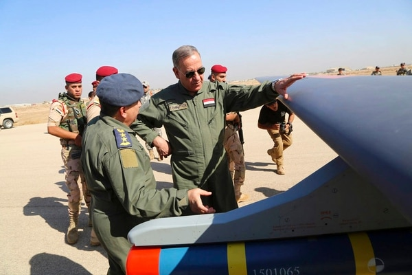 Iraqi Defense Minister Khaled al-Obeidi, center, inspects a first Chinese drone to be used by the Iraqi Air Force before sending it to bomb Islamic State group positions at an airbase in Kut, 160 kilometers (100 miles) southeast of Baghdad. Across the Middle East, countries locked out of purchasing U.S.-made drones due to rules over excessive civilian casualties are being wooed by Chinese arms dealers, who are world's main distributor of armed drones. The sales are helping expand Chinese influence across a region crucial to American security interests and bolstering Beijing's ambitions of being a world leader in high-tech arms sales. (AP)