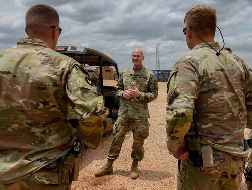 U.S. Army Brig. Gen. Damian T. Donahoe, deputy commanding general, Combined Joint Task Force - Horn of Africa, center, talks with service members during a battlefield circulation Sept. 5, 2020, in Somalia. (Senior Airman Kristin Savage/Combined Joint Task Force - Horn of Africa via AP)