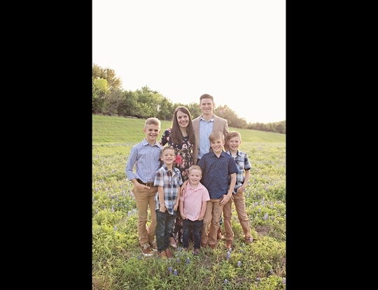 Air Force Maj. Matthew Checketts and his wife Jessica with their five children. The couple asked lawmakers to change law to allow service members to use their pre-approved parental leave after the death of a baby. (Photo courtesy Checketts family)