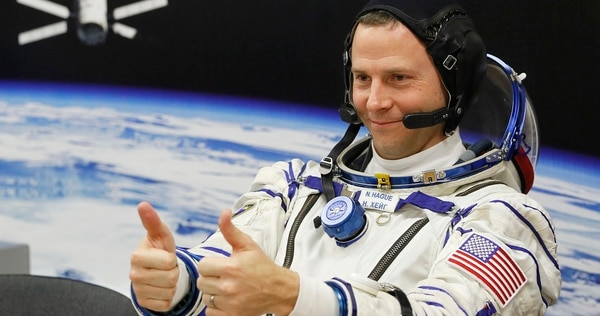 U.S. astronaut Nick Hague gestures prior to the launch of a Soyuz MS-12 space ship to the International Space Station Thursday. (Dmitri Lovetsky/AP)