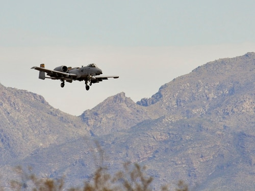 An Air Force A-10 Warthog out of Davis-Monthan Air Force Base, Ariz., flies into the Barry M. Goldwater Range during the Hawgsmoke bombing, missile and tactical gunnery competition in 2014. (Airman 1st Class Christopher Massey/Air Force)