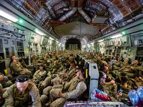 Marines assigned to the 24th Marine Expeditionary Unit fly to Hamid Karzai International Airport, Kabul, Afghanistan, Aug. 17. (1st Lt. Mark Andries/Marine Corps)